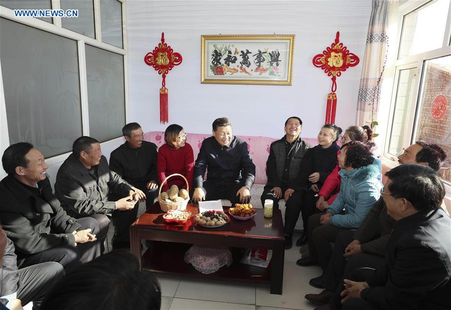 Xi pushes poverty alleviation