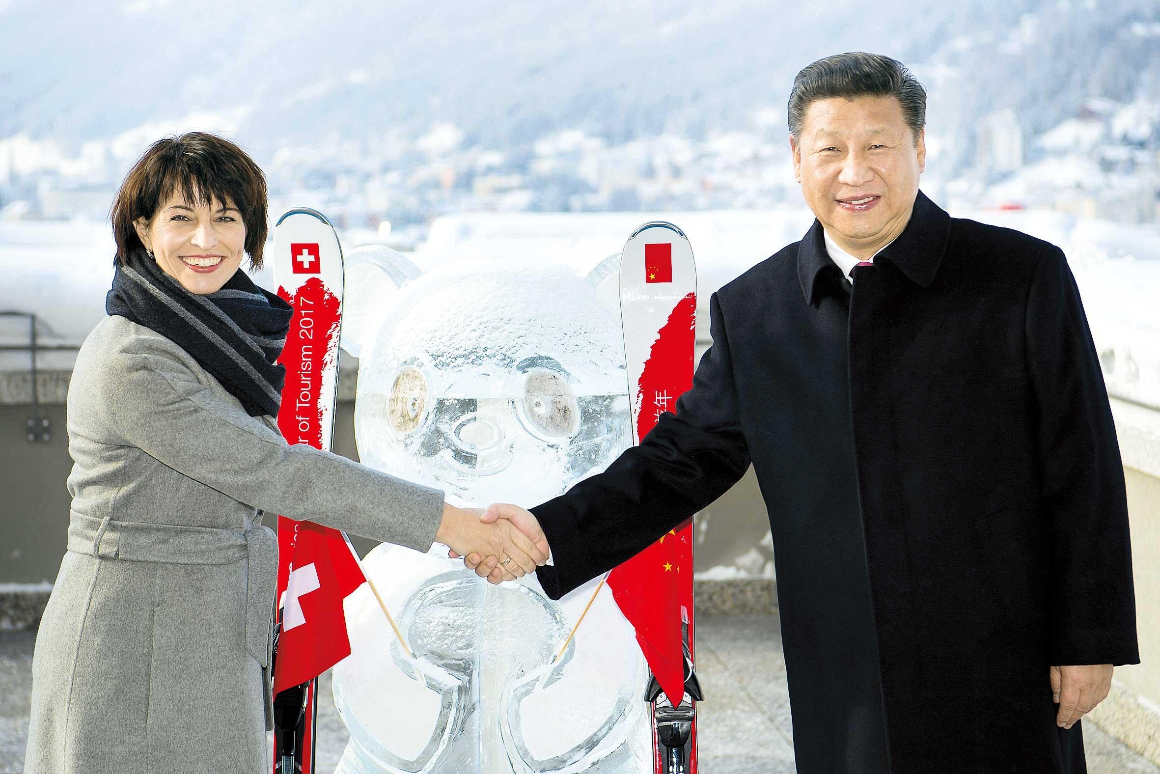 Xi warns world against trade war