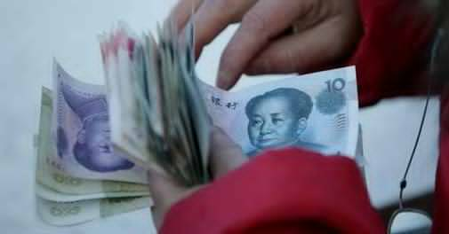 Chinese yuan, Indian rupee forecast to fall over coming year