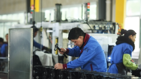 China's industrial output expansion beats expectations