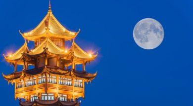moon over a pagoda in chengdu