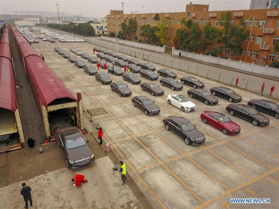 Commercial vehicles carried by China-Europe freight train finish customs clearance process