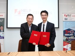 Professor Datuk Dr. Paul Chan, Vice Chancellor of HELP University, shakes hands and exchanges signed MOUs with Alex Lee, Managing Director of Celebrus Advisory